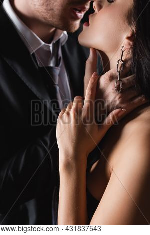 Partial View Of Passionate Man Touching Neck Of Woman With Closed Eyes