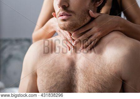 Partial View Of Girlfriend Hugging Shirtless Boyfriend