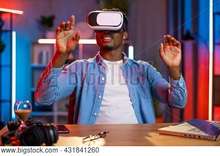 Positive African American Man Using Virtual Reality Glasses And Wireless Laptop While Working Remote