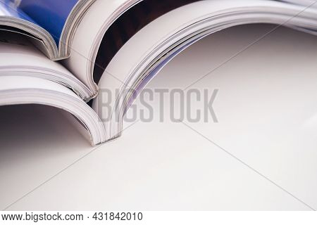 Pile Of Magazines Stack On White Table In Living Room, Close Up