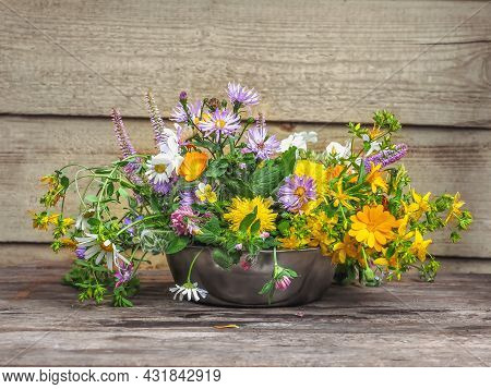 Delicate Bouquet Of Wild Flowers Close-up On The Porch Of A Village House