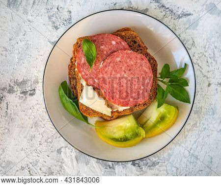 Quick Breakfast With Cheese And Sausage Sandwiches, Tomato Wedges And Basil