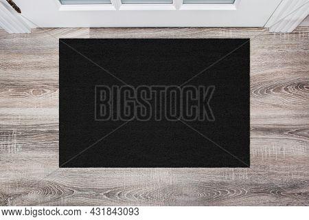 Black Coir Doormat On Wooden Floor In Front Of The Door. Product Mockup
