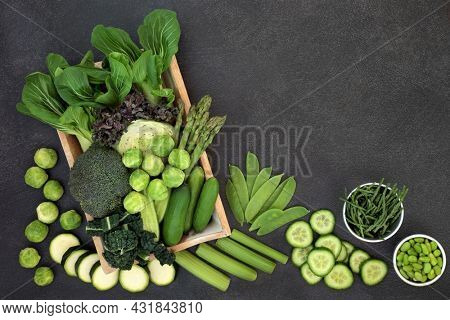 High fibre fresh green vegetables. Healthy vegan diet food high in antioxidants, smart carbs, vitamins, minerals. Sustainable, save the planet, eco friendly,  go green concept. Top view, flat lay.
