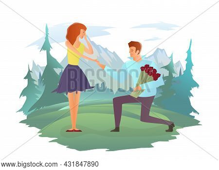 Young Couple In Love. Man And Woman On A Romantic Date In Mountain Landscape. Man With Flowers Makes