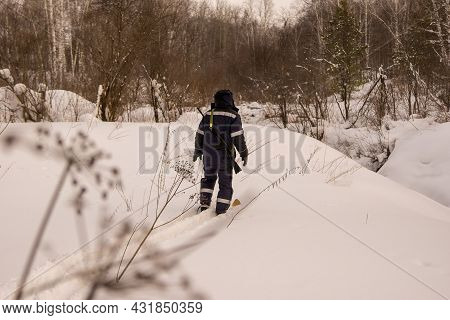 A Hunter On Skis Walks Through Deep And Loose Snow To The Descent Into A Ravine