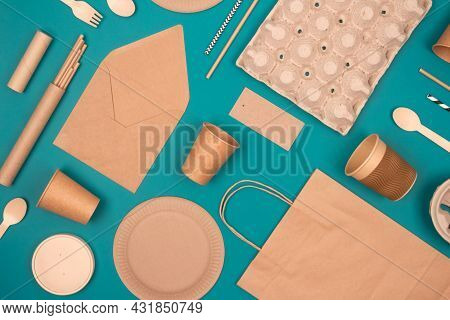 Flat Lay With Eco-friendly Tableware And Sustainable Packaging. Kraft Paper Food Packaging On Green