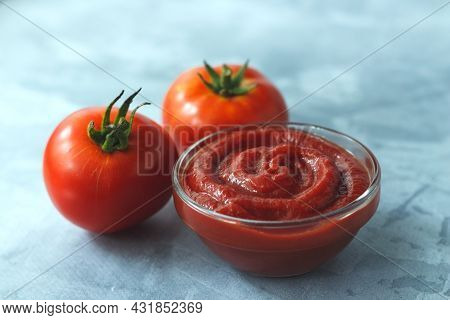 Tomato Paste From Fresh Tomatoes On Gray Background.