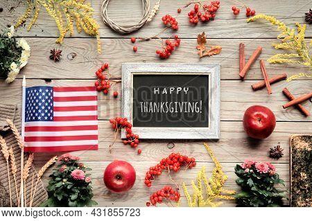 Thanksgiving Decorations With Usa Flag. Orange Hokkaido Pumpkins, Rowan Berry, Apples, Good Book And