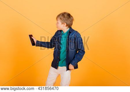 Grimacing Emotional Redhead Fasion Boy Posing In Yellow Studio