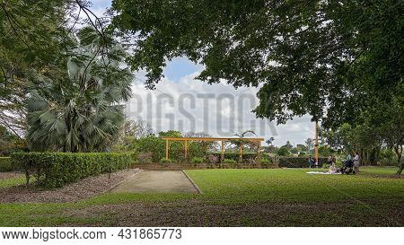 Mackay, Queensland, Australia - September 2021: Female Friends Having A Picnic In The Park With Thei