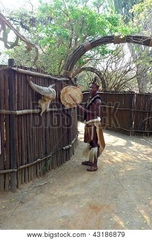 Zulu man in traditional closes greeting tourists in traditional closes in Shakaland Zulu Village