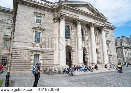 Dublin, Ireland - August 9 2017; Looking From Fence People Relax And Enjoy The Environment On Lawn A