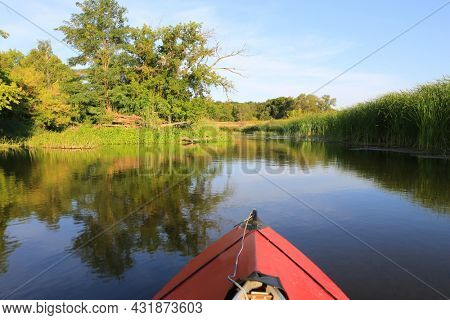 red kayak float on lake water in summer day