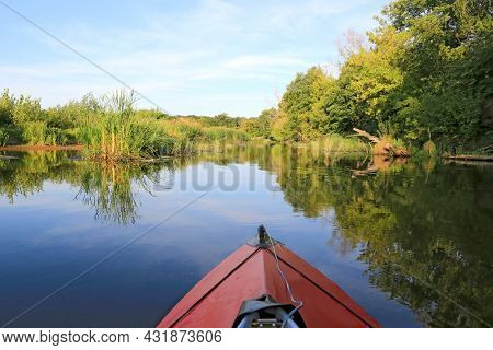 red kayak float on blue river water in summer time