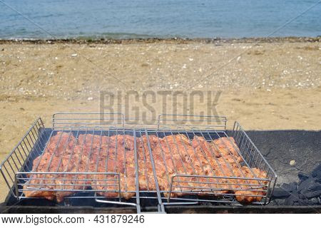 Barbecue On The Beach. Marinated Meat Is Fried On Hot Coals, Soaked In Fragrant Smoke. Selective Foc