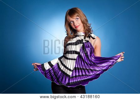 Beautiful Girl In Bright Clothes On A Blue