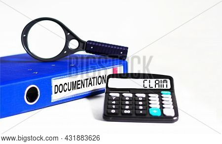 The Calculator Displays Text Claim. On A White Background Folder With Documents And A Magnifying Gla