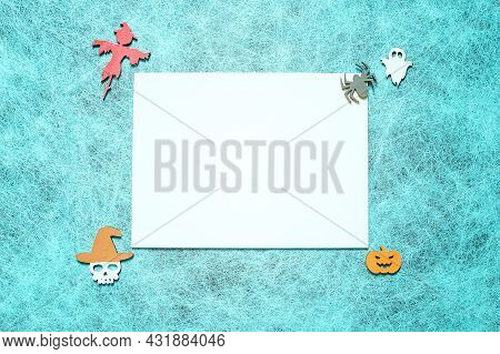 Holiday Helloween On A Spider Web Background With A White Leaf, Pumpkin, Ghost, Scarecrow, Skull, Wi