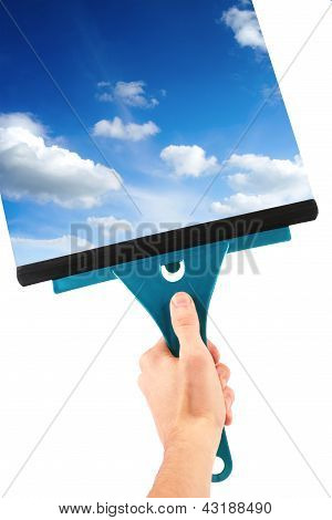 Hand With Window Cleaning Tool And Blue Sky