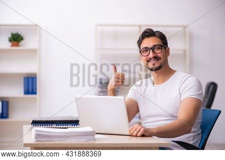 Young male student employee at workplace