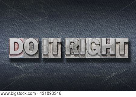 Do It Right Phrase Made From Metallic Letterpress On Dark Jeans Background