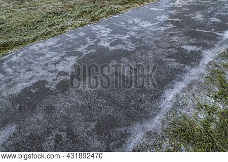 Slippery Road Covered Ice. Frozen Winter Way After Freezing Rain