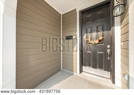 Small Porch Exterior With Light Brown Vinyl Wood Siding