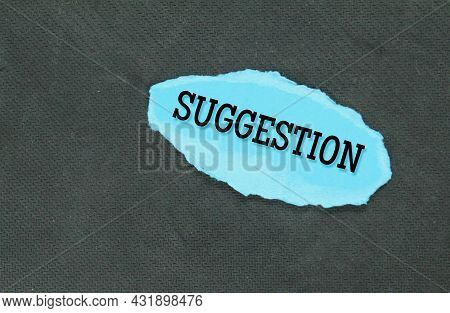 Torn Blue Paper With The Word Suggestion. Business Concept