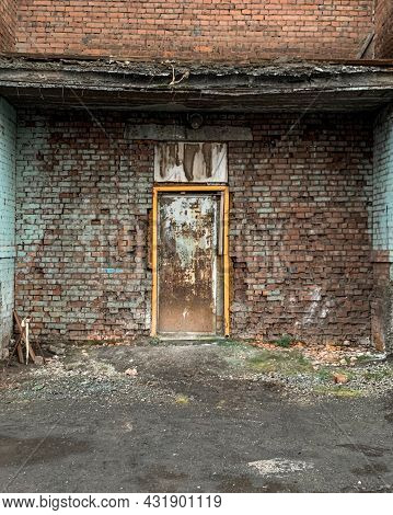 Wall Of The House. A Door That Cannot Be Entered. Non-residential Entrance. There Is A Wall Behind T
