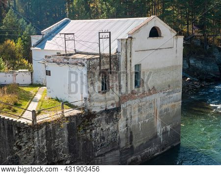 Building Of The Old Chemal Hydroelectric Power Station. Close-up. Chemal, Altai Republic, Russia.