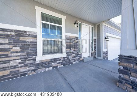 Front Porch Of A House With White Front Door And Two Side Panels