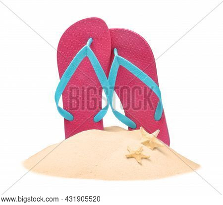 Pink Flip Flops In Sand And Starfishes On White Background