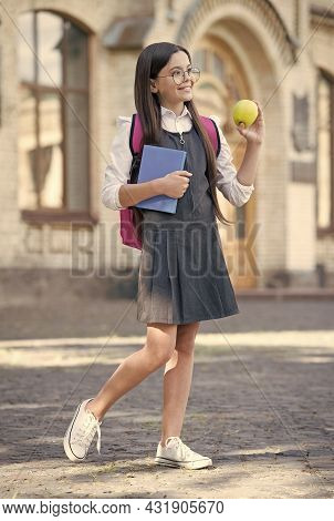Diet Makes Difference To Learning. Happy Child Hold Apple And Book. School Break. Fruit Snack. Diet