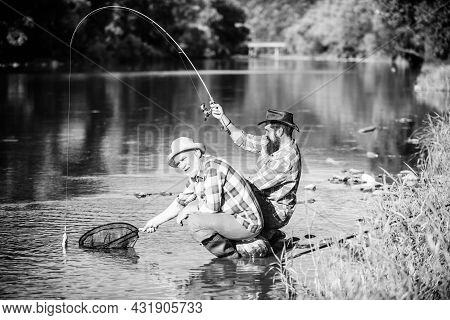 Fly Fisherman Fishing. Fly Fish Hobby Of Men. Retirement Fishery. Two Male Friends Fishing Together.