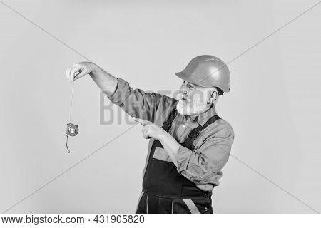 Man At Work. Construction Man Hold Measuring Tape. Engineering And Repair. Happy Carpenter. Handyman