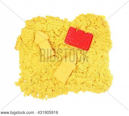 Yellow Kinetic Sand And Toy On White Background, Top View
