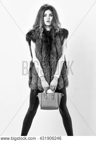Fashion Stylish Accessory. Fashion And Shopping Concept. Woman In Fur Coat With Handbag On White Bac