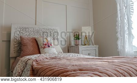 Pano Single Bed With Decorative Headboard And Feminine Blankets Inside A Home Bedroom