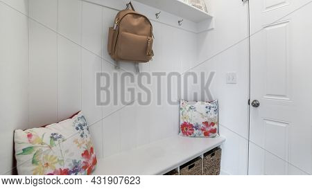 Pano Interior Of A White Mud Room With White Door, Built-in White Bench And Wall Mounted Hooks And S