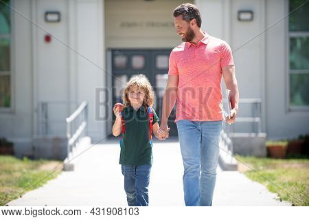 Happy Family Value. Childhood And Fatherthood. Parent Leads Little Child Boy In First Grade