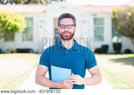 Arrogant Man In Eyeglasses Hold Paper. Vision Acuity. Eyesight. Vision Correction.