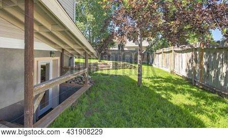 Pano Separate Basement Apartment Entrance With Stairs, Glass Panel And Trees On The Lawn At The Side