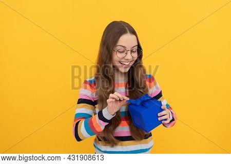 Amazed Kid In Eyeglasses Open Present Box For Holiday, Amazement