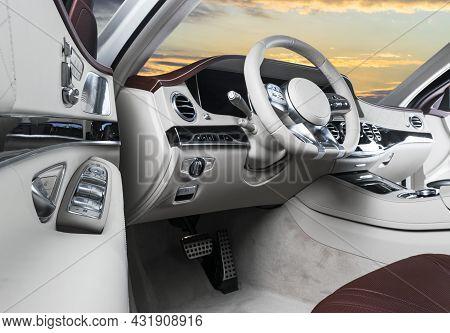 White Luxury Modern Car Interior. Steering Wheel And Dashboard. Detail Of Modern Car Interior. Autom