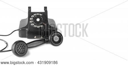 Vintage Phones - Black Retro Phone Is Picked Up On A White Background.