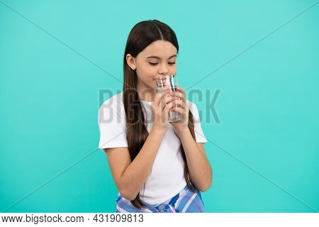 Drinking Per Day. Hydration Vitality. Be Hydrated. Kid Hold Glass Of Mineral Water.