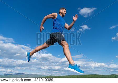 Sportsman Sprinter With Muscular Body Running In Sportswear Outdoor On Sky Background, Stamina.