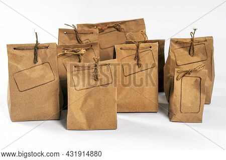 Some Craft Cardboard Pack Packages Tied With Raw Twine, With Empty Frame For Logo Stamped On Side, S
