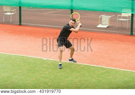 Tennis Player With A Tennis Racket Ready To Parry A Blow On An Artificial Tennis Court.